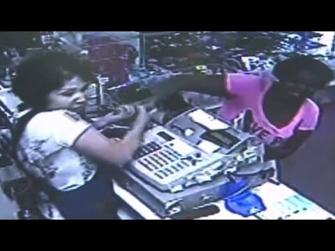 Thief With Baby Fights Clerk - Smashpipe News Video
