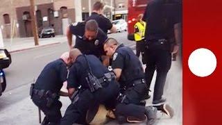 """He's just a kid!"" Onlookers horrified as 9 police arrest teen for 'jaywalking'"