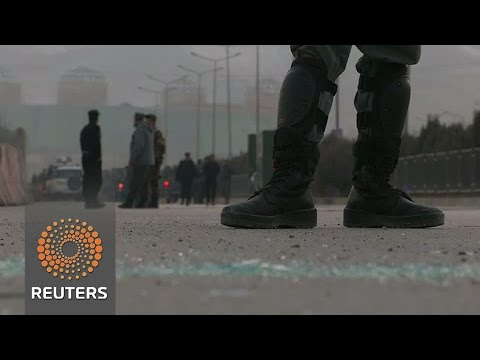Taliban attack near Afghan parliament kills more than 20