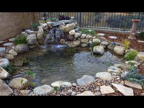 How to install a koi fish tunnel set rock as walls in for How to install a koi pond
