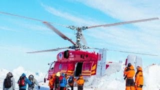 Helicopter rescues some off ship stuck in Antarctica