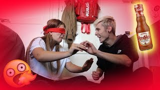 BLINDFOLDED TASTE TEST WITH MY GIRLFRIEND!!! (RED HOT CHILLI SAUCE)