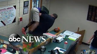 Video shows police body-slamming 14-year-old student