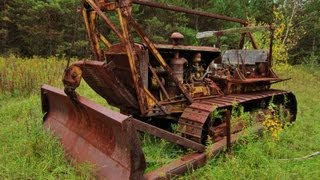 Caterpillar D8 bulldozer hauling out 100 foot tree and pony motor