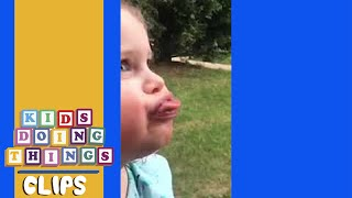 Slow Mo of Little Girl Making a Funny Face   Kids Doing Things Clips