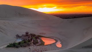 Live: Crescent-shaped lake surrounded by deserts in NW China