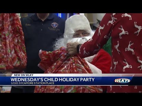 Santa stops by Wednesday's Child holiday party