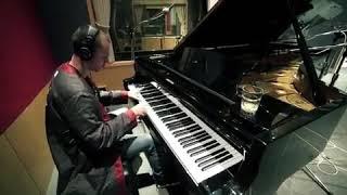 Logic - playing the piano.