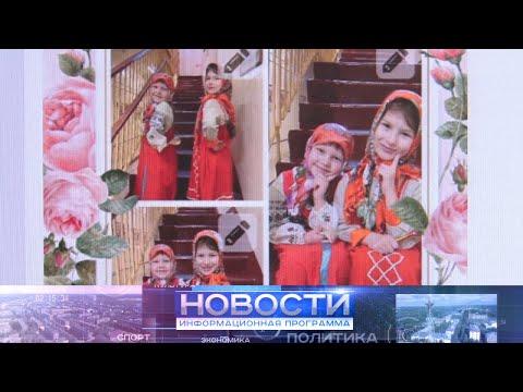 Жители Приполярья участвуют в конкурсе, демонстрируя национальные костюмы.