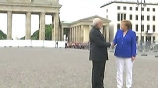 PM Modi, Angela Merkel shake hands in front of Brandenburg Gate
