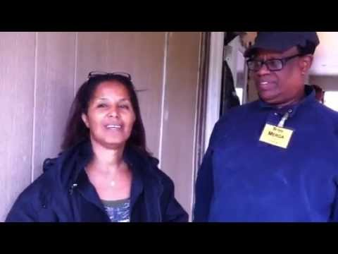 Luchia and Merga Give Thanks to Austin Habitat Board