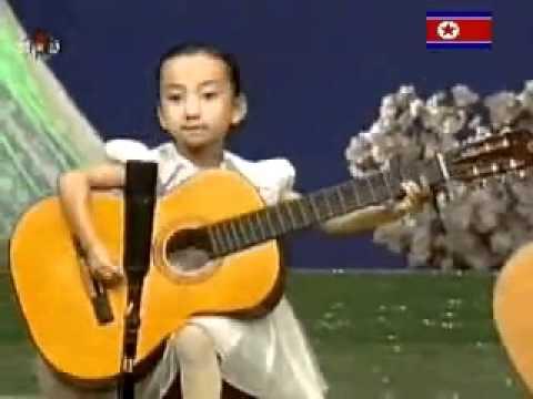 niños genios con la  guitarra