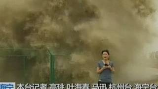 Huge wave lands on TV reporter ..
