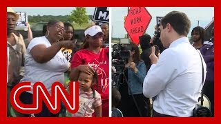 Angry protesters confront Mayor Pete Buttigieg
