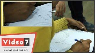 عبد الرحمن quotالراقص مع الكلابquot يرسم داخل صالة التحرير باليوم السابع ...