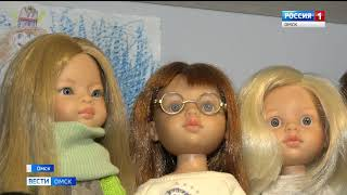 Многодетная омичка создает наряды для кукол