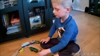 Rue shows off his wooden toy trains and track! Come watch the fun