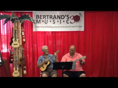 The Wong Chong brothers trying our new ukuleles at our Inland Empire location