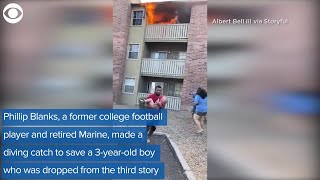 Man catches three-year-old dropped from burning building, ..