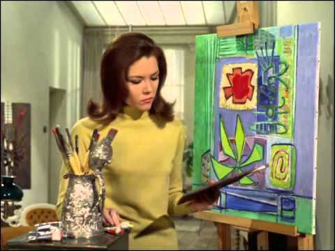Youtube video - Mrs peel is painting a modernist picture, she turns to refresh he brush and when she returns, she finds that Steed has signed the corner 'MRS PEEL'; he smiles at her and says, 'We're needed'