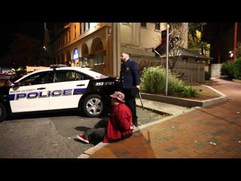 Guy Spits A Freestyle Outside A Police Station While Getting Arrested.