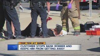Bank robber shot by customer