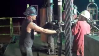Hard Work For Floor Man On Drilling Rig
