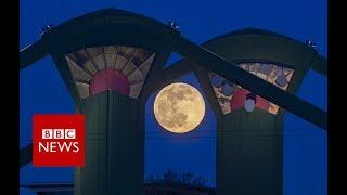 'Super snow moon' lights up the skies- BBC News