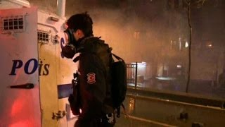 CNN crew caught in police tear gas