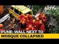 15 dead after apartment complex wall crashes in Pune