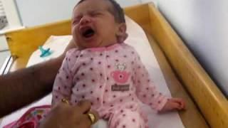 Baby's first shot for HEPATITIS-B by Doctor