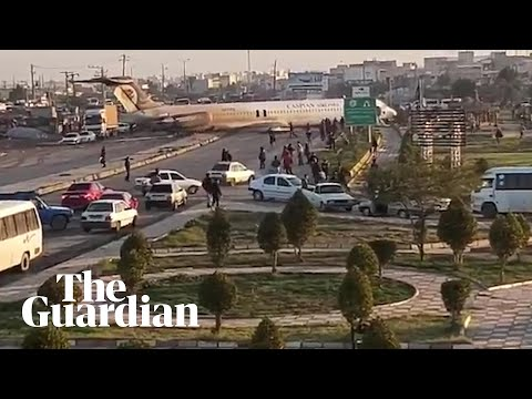 Iranian passenger plane lands in the middle of a city street