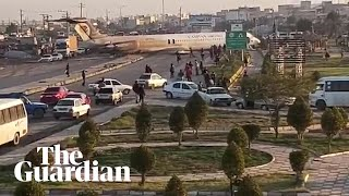 Iranian passenger plane lands in the middle of a city stre..