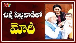 Photos of PM Modi Playing with Baby in Parliament go Viral..