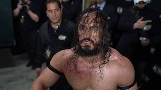 Hangman Page is confronted by PAC during the AEW All Out Post Show