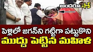 Woman hugs and kisses Jagan in a marriage event..