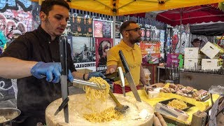 Italian Soft Fresh Spaghetti Savoured in a Cheese Wheel. London Street Food