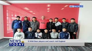 13 Wild Boar players and coach visit England