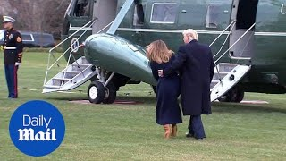 President Trump catches First Lady Melania as she stumbles - Daily Mail