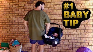 How to carry a baby car seat = MIND BLOWN.