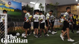 Rescued Thai boys kick footballs at beginning of press conference