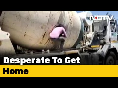 Migrants travelling by hiding in cement concrete mixer held