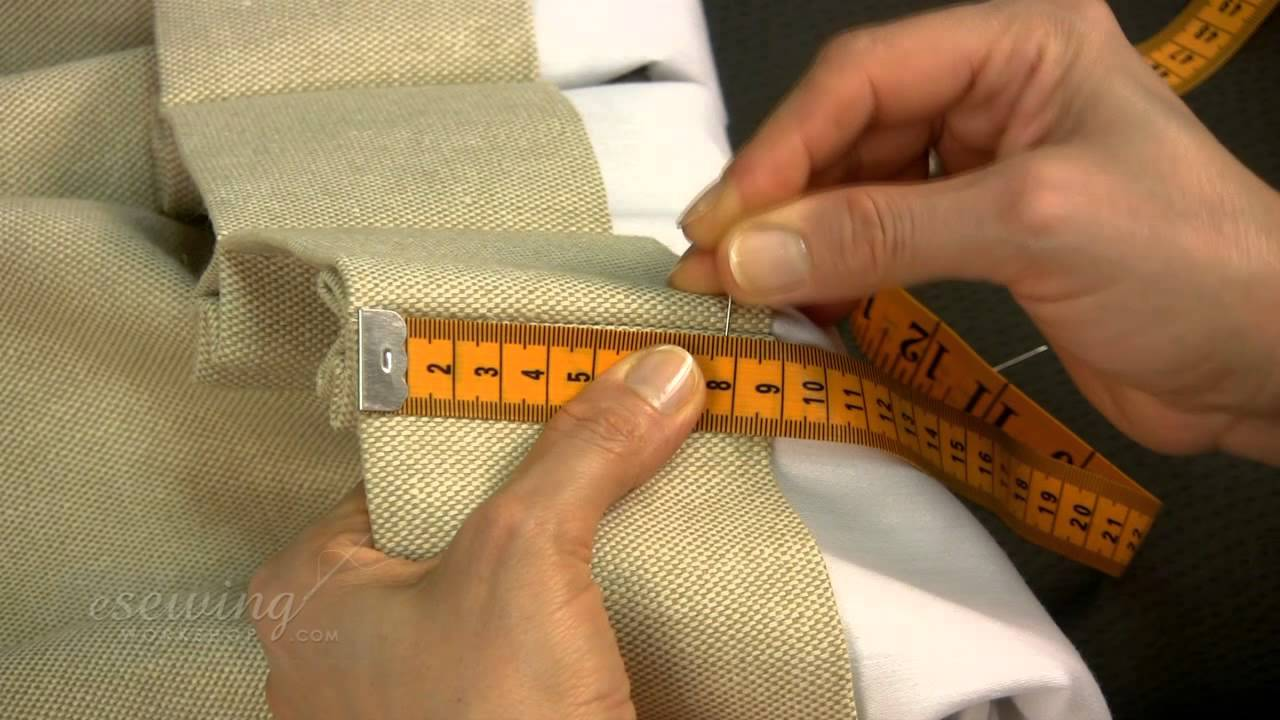 Inserting The Pin Hooks For Pinch Pleat Curtains Hung On