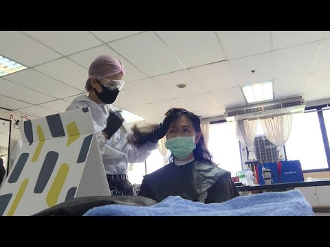 A cut above the rest: Volunteer hairdressers help Thai healthcare workers | AFP photo