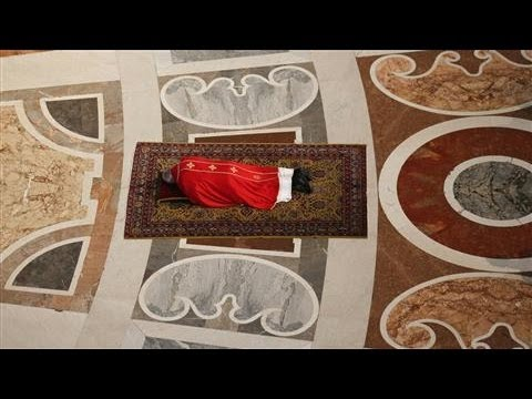 Photos of the Day - Pope Francis Lies Flat to Pray