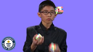 He JUGGLED and SOLVED 3 Rubik's cubes! - Guinness World Records