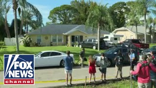 Brian Laundrie's parents brought out of family home during FBI search