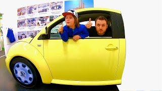 driving-in-my-car-song-ride-on-yellow-vw-beetle-at-childrens-museum-pretend-play-mechanic.jpg
