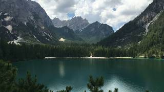 Alps mountains, lake in the mountains with beautiful blue clear water, Italy Alps