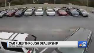 Caught on Camera: Car gets airborne in dealership lot